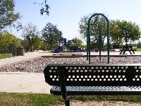 bench and swing set in willis park